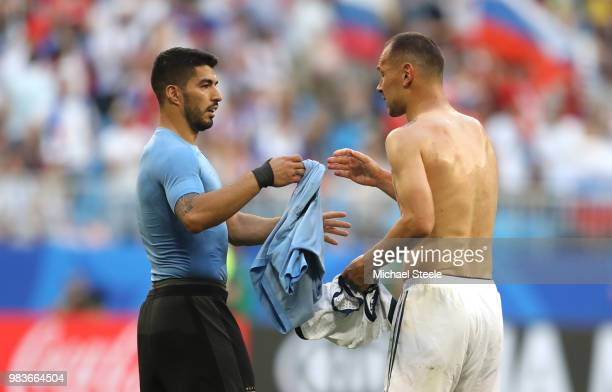 Luis Suarez of Uruguay congratulates Sergey Ignashevich of Russia following the 2018 FIFA World Cup Russia group A match between Uruguay and Russia...