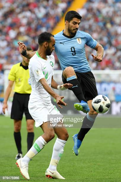 Luis Suarez of Uruguay controls the ball infront of Abdullah Otayf of Saudi Arabia during the 2018 FIFA World Cup Russia group A match between...