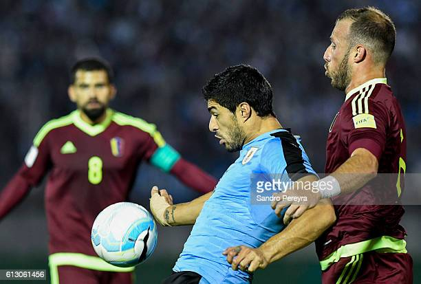 Luis Suarez of Uruguay fights for the ball with Jose Velazquez of Venezuela during a match between Uruguay and Venezuela as part of FIFA 2018 World...