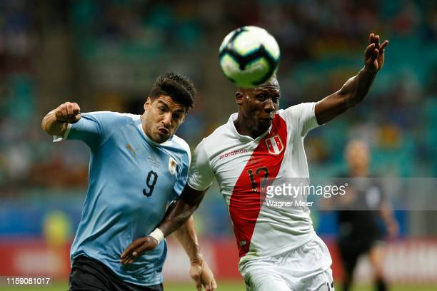 Luis Suarez of Uruguay fights for the ball with Luis Advincula of Peru during the Copa America Brazil 2019 quarterfinal match between Uruguay and...