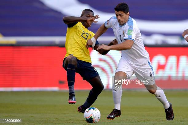 Luis Suarez of Uruguay fights for the ball with Moises Caicedo of Ecuador during a match between Ecuador and Uruguay as part of South American...
