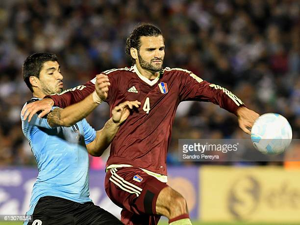 Luis Suarez of Uruguay fights for the ball with Oswaldo Vizcarrondo of Venezuela during a match between Uruguay and Venezuela as part of FIFA 2018...