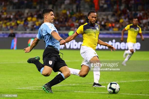 Luis Suarez of Uruguay in action with Arturo Mina of Ecuador during the Copa America Brazil 2019 group C match between Uruguay and Ecuador at...