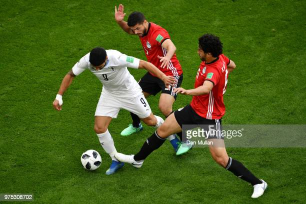 Luis Suarez of Uruguay is challenged by Ahmed Hegazy and Marwan Mohsen of Egypt during the 2018 FIFA World Cup Russia group A match between Egypt and...