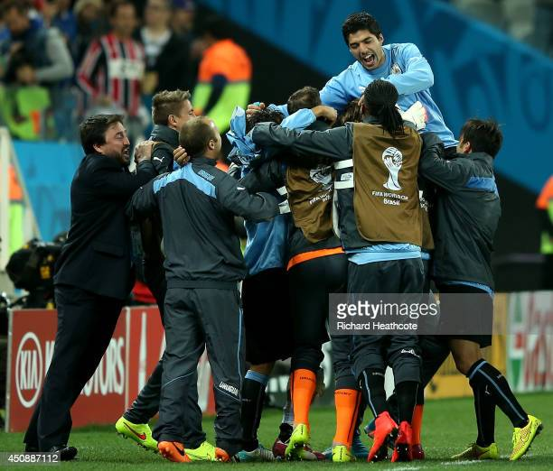 Luis Suarez of Uruguay is lifted up by teammates in celebration after defeating England 21 during the 2014 FIFA World Cup Brazil Group D match...