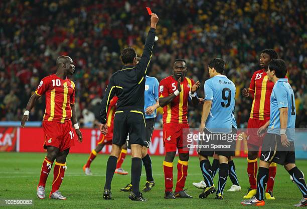 Luis Suarez of Uruguay is sent off by Referee Olegario Benquerenca after handling the ball on the goal line during the 2010 FIFA World Cup South...