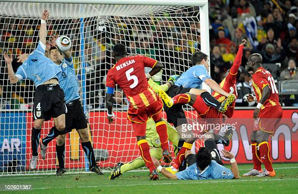 Luis Suarez of Uruguay handles the ball on the goal line for which he was sent off during the 2010 FIFA World Cup South Africa Quarter Final match...