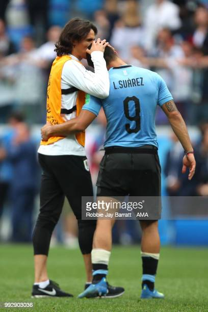 Luis Suarez of Uruguay lis consoled b Edison Cavani of Uruguay at the end of the 2018 FIFA World Cup Russia Quarter Final match between Uruguay and...
