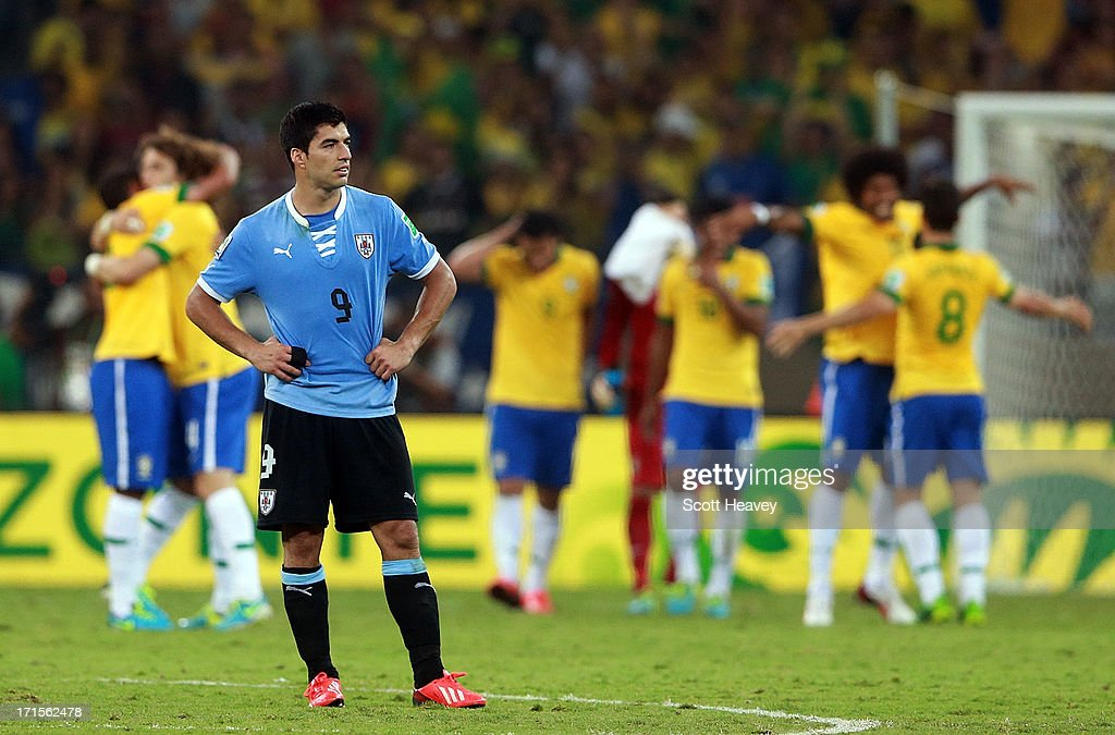 Luis Suarez of Uruguay looks dejected at the end of the FIFA Confederations Cup Brazil 2013 Semi Final match between Brazil and Uruguay at Governador Magalhaes Pinto Estadio Mineirao on June 26, 2013 in Belo Horizonte, Brazil.