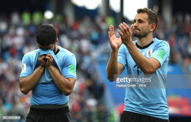 Luis Suarez of Uruguay looks dejected while Cristhian Stuani acknowledges the fans following their sides defeat in the 2018 FIFA World Cup Russia...