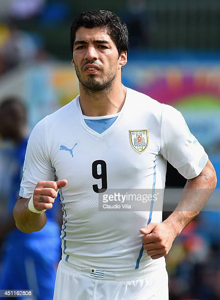 Luis Suarez of Uruguay looks on during the 2014 FIFA World Cup Brazil Group D match between Italy and Uruguay at Estadio das Dunas on June 24 2014 in...