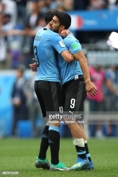 Luis Suarez of Uruguay ls consoled by Diego Godin of Uruguay at the end of the 2018 FIFA World Cup Russia Quarter Final match between Uruguay and...