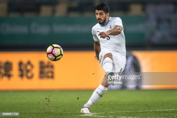 Luis Suarez of Uruguay national football team kicks the ball to make a shoot against Wales national football team in their final match during the...