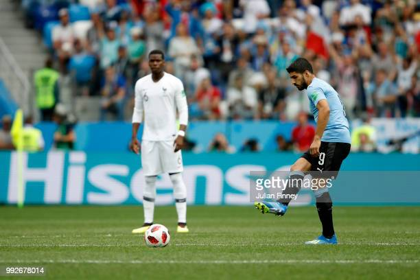 Luis Suarez of Uruguay passes the ball at kick off during the 2018 FIFA World Cup Russia Quarter Final match between Uruguay and France at Nizhny...