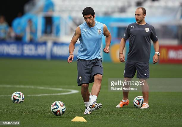 Luis Suarez of Uruguay performs passing drills during a Uruguay training session ahead of the 2014 FIFA World Cup Brazil match against England at...