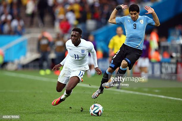Luis Suarez of Uruguay reacts after a challenge on Danny Welbeck of England during the 2014 FIFA World Cup Brazil Group D match between Uruguay and...