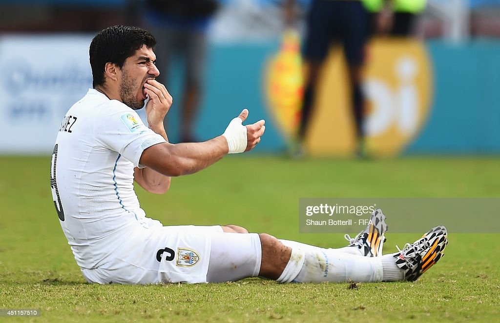 Luis Suarez of Uruguay reacts after a clash with Giorgio Chiellini of Italy during the 2014 FIFA World Cup Brazil Group D match between Italy and Uruguay at Estadio das Dunas on June 24, 2014 in Natal, Brazil.