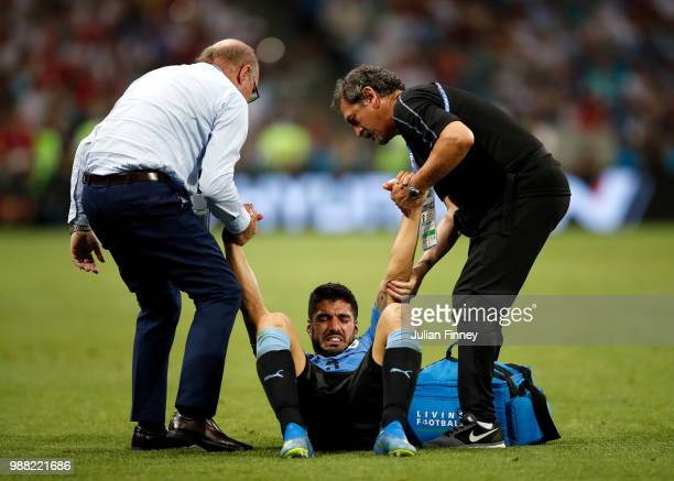Luis Suarez of Uruguay receives treatment during the 2018 FIFA World Cup Russia Round of 16 match between Uruguay and Portugal at Fisht Stadium on...