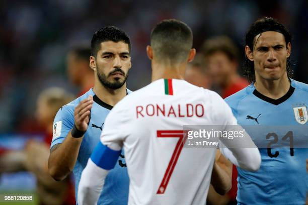 Luis Suarez of Uruguay sahkes hands wuth Cristiano Ronaldo of Portugal during the 2018 FIFA World Cup Russia Round of 16 match between Uruguay and...