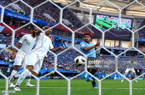 Luis Suarez of Uruguay scores his team's first goal during the 2018 FIFA World Cup Russia group A match between Uruguay and Saudi Arabia at Rostov...
