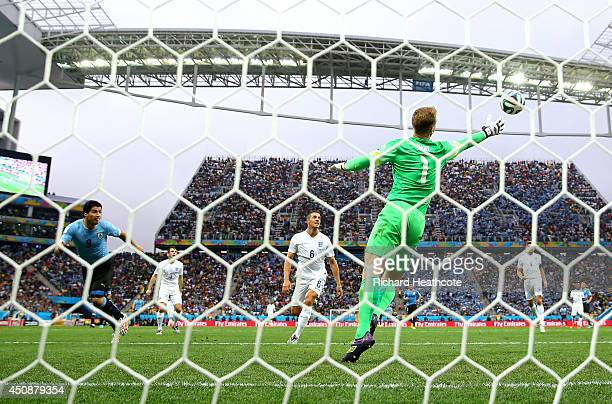 Luis Suarez of Uruguay scores his team's first goal past Joe Hart of England during the 2014 FIFA World Cup Brazil Group D match between Uruguay and...