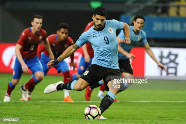 Luis Suarez of Uruguay scores his team's first goal with a penalty during the 2018 China Cup International Football Championship match between...