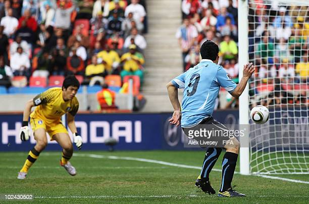 Luis Suarez of Uruguay scores the opening goal during the 2010 FIFA World Cup South Africa Round of Sixteen match between Uruguay and South Korea at...