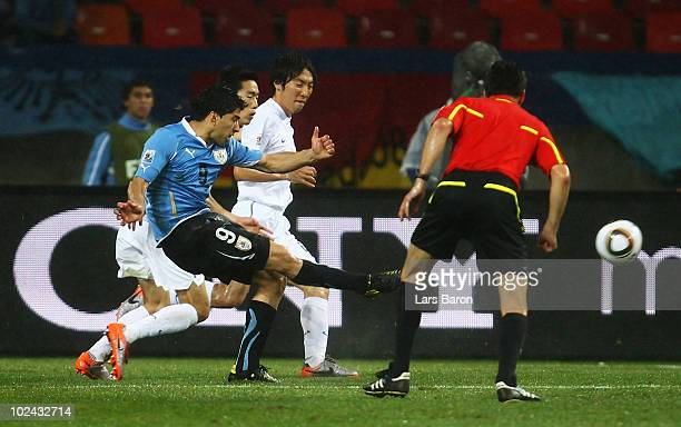 Luis Suarez of Uruguay shoots and scores his second goal during the 2010 FIFA World Cup South Africa Round of Sixteen match between Uruguay and South...