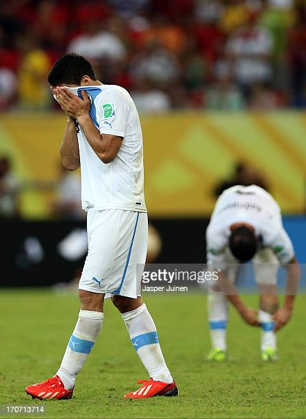 Luis Suarez of Uruguay shows his dejection at the end of the FIFA Confederations Cup Brazil 2013 Group B match between Spain and Uruguay at the Arena...