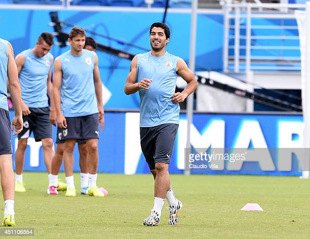 Luis Suarez of Uruguay smiles during a training session at the Dunas Arena in Natal on June 23 2014 in Natal Brazil