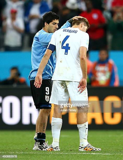 Luis Suarez of Uruguay speaks to Steven Gerrard of England after England's loss to Uruguay 21 during the 2014 FIFA World Cup Brazil Group D match...