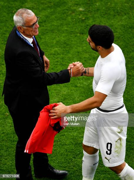 Luis Suarez of Uruguay speaks with Hector Cuper, Head coach of Egypt following the 2018 FIFA World Cup Russia group A match between Egypt and Uruguay...