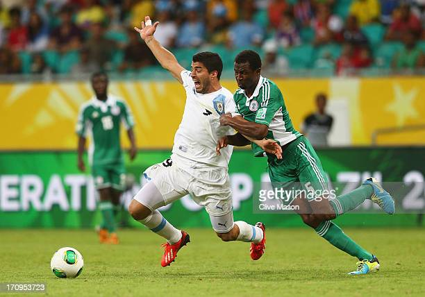 Luis Suarez of Uruguay tangles with Efe Ambrose of Nigeria during the FIFA Confederations Cup Brazil 2013 Group B match between Nigeria and Uruguay...