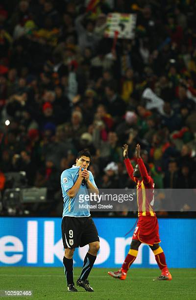 Luis Suarez of Uruguay walks off after being shown the red card for deliberate hand ball on the goal line during the 2010 FIFA World Cup South Africa...