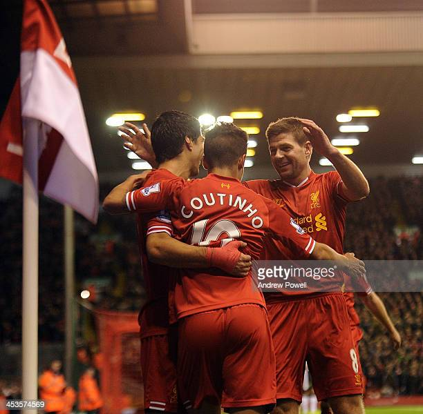 Luis Suarez Philippe Coutinho and Steven Gerrard of Liverpool celebrate the third goal during the Barclays Premier League match between Liverpool and...