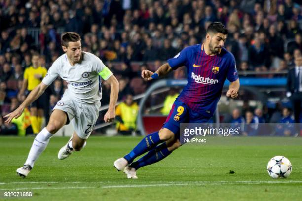 Luis Suarez vies with Cesar Azpilicueta during the UEFA Champions League match between FC Barcelona and Chelsea FC at the Camp Nou Stadium in...