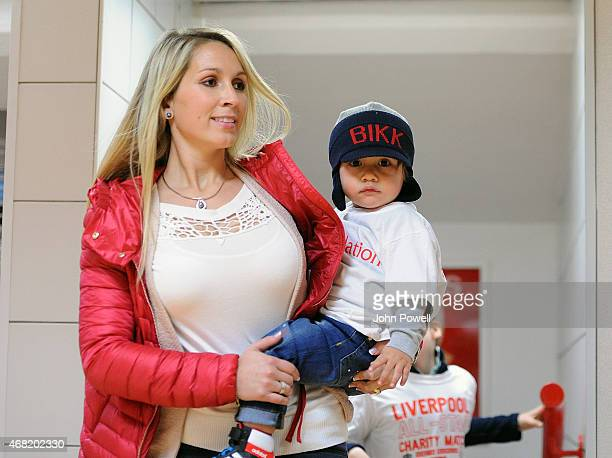Luis Suarez wife Sofia Balbi and child arrive at the Liverpool All Star Charity Match at Anfield on March 29 2015 in Liverpool England