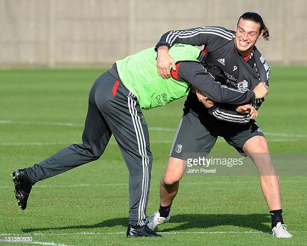 Luis Suarez wrestles with Andy Carroll of Liverpool during a training session at Melwood Training Ground on November 4 2011 in Liverpool England