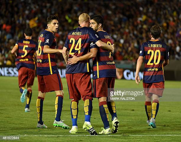 Luis Suárez of FC Barcelona celebrates with teammates after scoring against the Los Angeles Galaxy during their International Champions Cup game at...