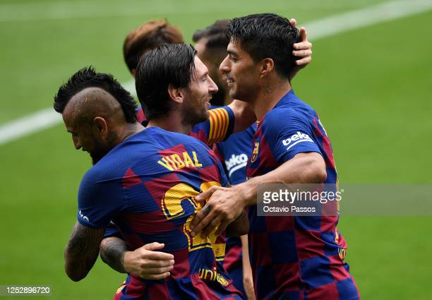 Luis Suárez of FC Barcelona is congratulated by team mate Lionel Messi after scoring the opening goal during the Liga match between RC Celta de Vigo...