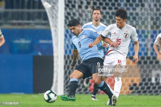 Luis Suárez of Uruguay battles for the ball against Takehiro Tomiyasu during the Copa America Brazil 2019 group C match between Uruguay and Japan at...