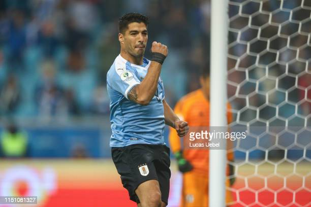 Luis Suárez of Uruguay celebrates after scoring his team's first goal during the Group C match between Uruguay and Japan during Copa America Brazil...