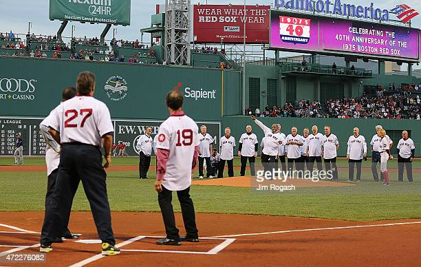 Luis Tiant throws to MLB Hall of Famer Carlton Fisk during a celebration of the 1975 American League Champions before a game between Boston Red Sox...