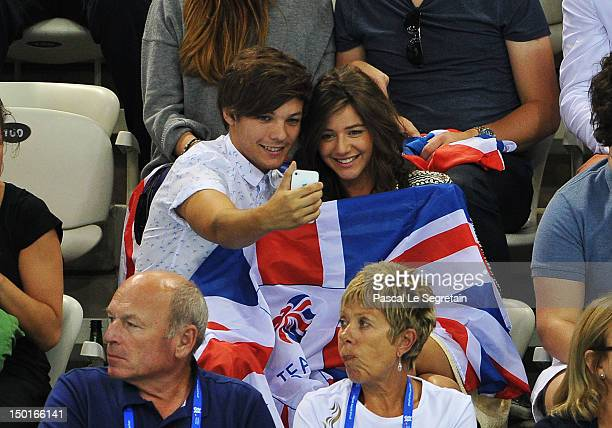 Luis Tomlinson of One Direction and girlfriend Eleanor Calder during the Men's 10m Platform Diving Final on Day 15 of the London 2012 Olympic Games...