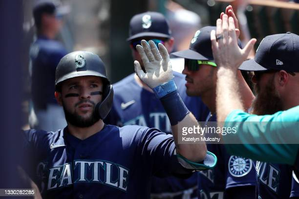 Luis Torrens of the Seattle Mariners celebrates his home run with teammates in the dugout during the fourth inning against the Los Angeles Angels at...