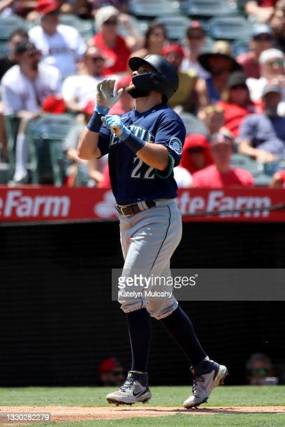 Luis Torrens of the Seattle Mariners reacts after his home run during the fourth inning against the Los Angeles Angels at Angel Stadium of Anaheim on...