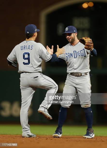 Luis Urias and Greg Garcia of the San Diego Padres celebrate after a win against the San Francisco Giants at Oracle Park on August 31 2019 in San...