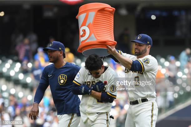 Luis Urias of the Milwaukee Brewers hits a walk-off single in the 10th inning against the Detroit Tigers at American Family Field on May 31, 2021 in...