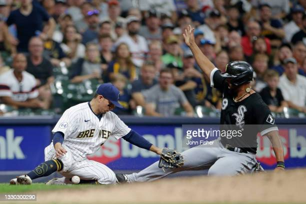 Luis Urias of the Milwaukee Brewers looses the ball while attempting to tag out a sliding Jose Abreu of the Chicago White Sox in the sixth inning at...