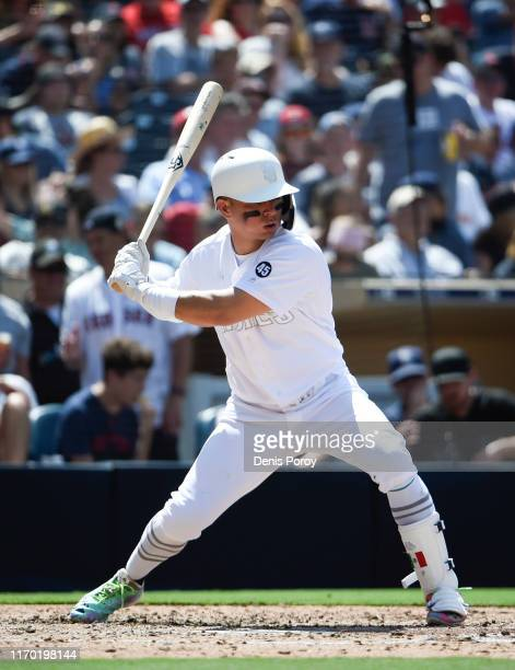 Luis Urias of the San Diego Padres bats during a baseball game against the Boston Red Sox at Petco Park August 25 2019 in San Diego California Teams...